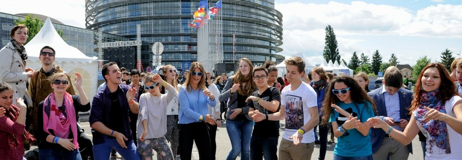 Participants dancing in front of the EP building