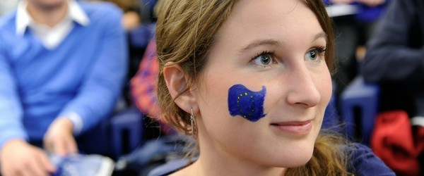 Girl smiling with EU flag painted on her cheek