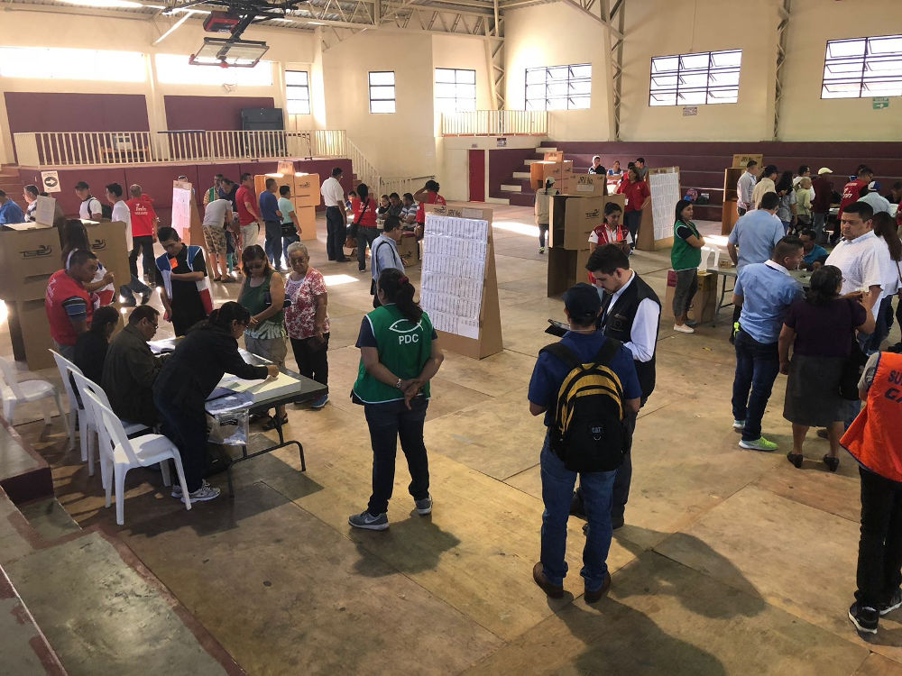 The inside of a large hall used as a polling station in El Salvador