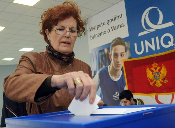 A woman casts her vote in Montenegro's presidential election on 15 April 2018