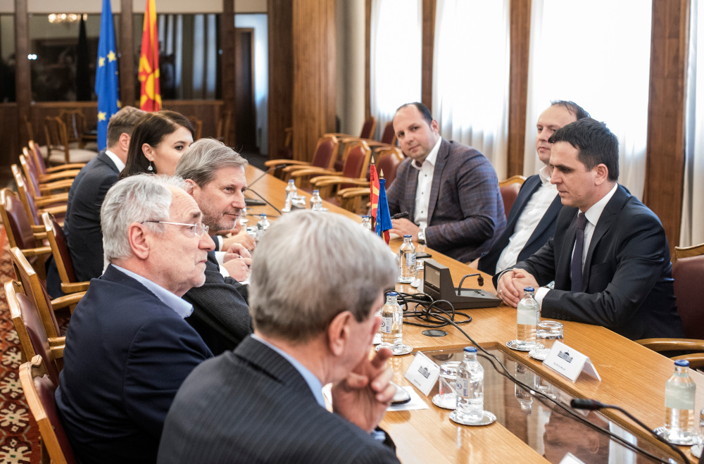 Johannes Hahn, European Commissioner for European Neighbourhood Policy and Enlargement Negotiations and MEPs Ivo Vajgl and Eduard Kukan sit around a large conference table with Bilall Kasami, Leader of the Besa Movement, in Skopje, Macedonia